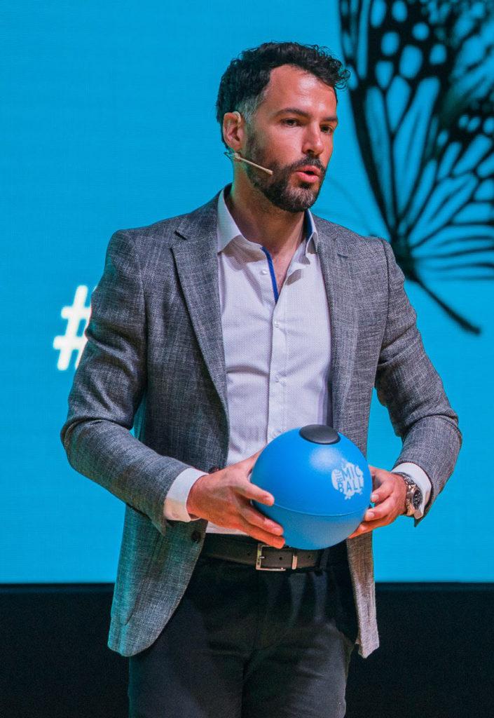 David Urankar holding a spherical, bouncy microphone