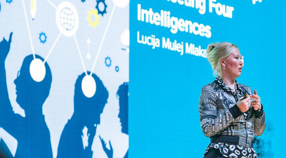 Lucija Mulej Mlakar speaking on stage