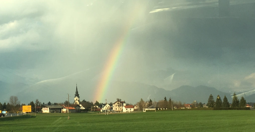 Rainbow falls on a Slovenian village
